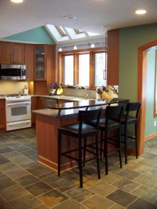 Okemos Addition Description: New Granite countertops in Kitchen.  New cabinets.  Floating bar top. Slate floor tile.