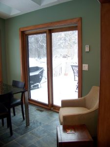 Okemos Addition Description: New sliding patio door to deck.