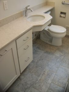 East Lansing Aging in Place Bathroom Remodel - Description: New vanity cabinets with clothes hamper, open area under lavatory, new recessed medicine cabinet, updated electrical, new toilet, new tile floor, new frosted window, grab bars.