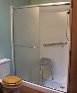 Williamston Aging in Place Bathroom Remodel - Description: Removed existing tub/shower unit and replaced with new fiberglass shower unit.  Installed grab bars and hand held shower unit.