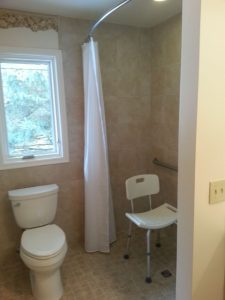 Okemos Aging in Place Bathroom Remodel - Description: Removed tub unit and replaced with zero threshold tile shower.  Added grab bars and hand held shower unit.