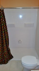 East Lansing Barrier Free Shower Description: East Lansing Bathroom. Removed existing tub and installed new Barrier Free, Low threshold fiberglass shower unit. Installed grab bars and hand-held shower head.