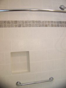 East Lansing Aging in Place - Bathroom Remodel - Description: Decorative grab bar under niche in tile tub surround.