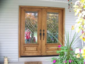 Okemos Exterior Door Description: Replaced existing exterior door with new Oak door.