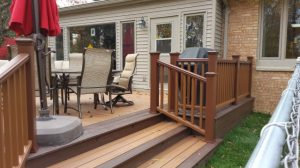 Okemos Rear Deck Description: 22x16 rear deck using Trex decking, railings, and lights.