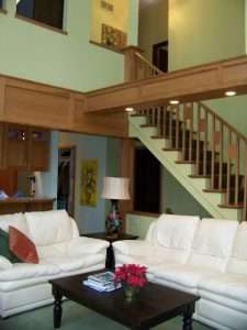 Dewitt Interior Remodel After Description: Removed paneling from walls.  Rebuilt existing staircase and railing.  Built kneewall under staircase.  Custom woodwork to match existing cabinets in adjacent room.