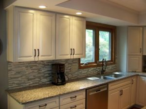 Okemos Kitchen Remodel Description: New cabinets, Quartz countertops and Island, tile backsplash, new stainless steel sink, new faucet, updated lighting, crown moulding, paint.