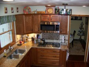 Okemos Kitchen Remodel Description: New cabinets, Quartz countertops, tile backsplash, hardwood flooring, updated electrical and plumbing, new patio door, undermount stainless steel sink, new faucet.