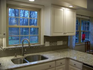 Okemos Kitchen Remodel After Description: New Cabinets, granite countertop, tile backsplash, updated electrical, sink and faucet.