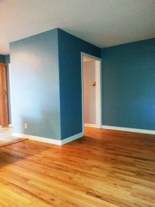 East Lansing Kitchen Remodel Description: Refinished hardwood floor, painted walls and trim.
